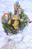 Christmas composition with champagne, candy canes and Santa — Stock Photo