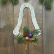 Christmas bell on wooden background — Stock Photo