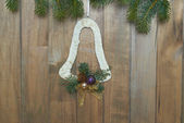 Christmas bell on wooden background — Foto Stock