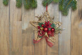 Christmas star on wooden background — Stock Photo
