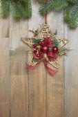 Christmas star on wooden background — Zdjęcie stockowe