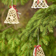 Christmas lace bells with red ribbons — Stock Photo #52991749
