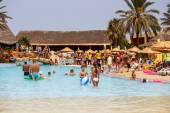 Tourists on holiday in pool, Tunisia — Stock Photo