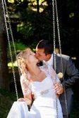 Beautiful young wedding couple kissing — Stock Photo