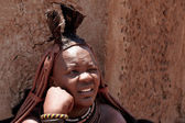 Himba woman with ornaments on the neck in the village — Stock Photo