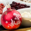 Red christmas bal with chocolate nuts — Stock Photo #61269719