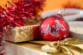 Christmas decoration and golden box with ribbon — Stock Photo