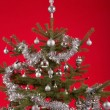 Decorated christmas tree on red background — Stock Photo #64035195