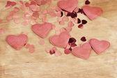 Valentine's fabric and confetti hearts on a wooden retro design background — Stock Photo