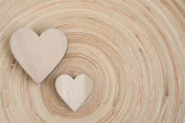 Valentine's wooden hearts on a wooden background — Stockfoto