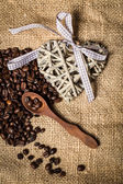 Pile of fresh coffee beans, heart and spoon — Stock Photo
