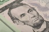Macro of Abraham Lincoln on five USA dollar banknote — Stock Photo