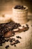 Pile of fresh and bio aromatic coffee beans and spoon — Stock Photo