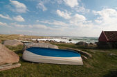 Wooden boat on the shore — Stock Photo