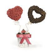 Roses and coffee beans topiary — Stock Photo
