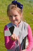 The girl assistant  holding the grey card — Stock Photo