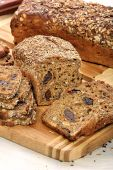 Wholemeal bread with grains and plums — Stock Photo