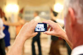 Man making a picture during the reception party — Stock Photo