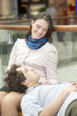 Love couple in shopping center — Stock Photo