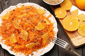 Christmas salad from carrots with orange, raisins and roasted se — Stock Photo