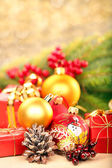 Christmas decorations with space for text on golden blurry light — Stock Photo