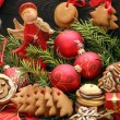 Christmas decoration with gingerbread on wooden background — Stock Photo #57013183