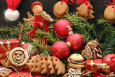 Christmas decoration with gingerbread on wooden background — Stock Photo
