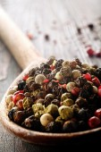 Color pepper on wooden spoon — Stock Photo