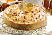 Christmas cheesecake caramel with nuts — Stock Photo