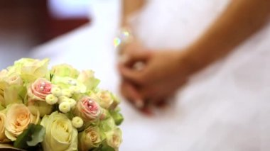 The bride with a wedding bouquet during the marriage ceremony in church — Stock Video