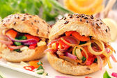 Vegetarian sandwich with fried onions and peppers — Stock Photo