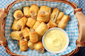White sausage in puff pastry with joppie sauce — Stock Photo