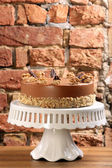 Walnut cake on white plate — Stock Photo