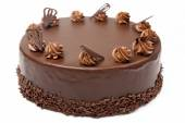 Cream chocolate cake with icing on white background — Stock Photo