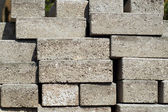 Stacked building bricks outside in sunshine — Stock Photo