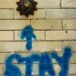 The word stay graffitied on an old tiled wall — Stock Photo #67258189