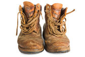 Pair of brown leather work boots on white — Stock Photo