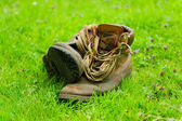 Pair of old boots on grass — Stock Photo