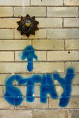 The word stay graffitied on an old tiled wall — Stockfoto