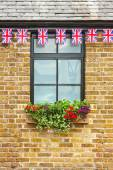 Window with Union Jack bunting above — Stock Photo