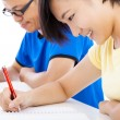 Two young students studying together in classroom — Stock Photo #52148635