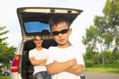 Happy children and father with their car in the park — Stock Photo