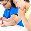 Two young students learning together in classroom — Stock Photo #52255675