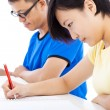 Two young students learning together in classroom — Stock Photo #52636677