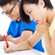 Two young students exams together in classroom — Stock Photo #52636685