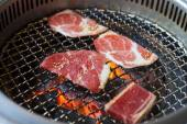 Closeup of meat on a grill or barbecue  — Stock Photo