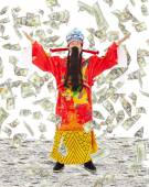 God of wealth share  riches and prosperity with money rain — Stock Photo