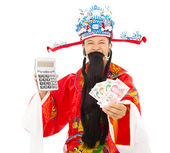 God of wealth holding a compute machine and chinese currency — Stock Photo