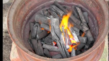 Burning charcoal in metal rim — Stockvideo