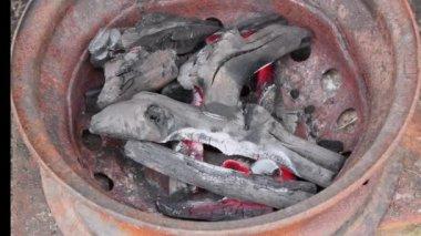 Burning charcoal in metal rim — Stock Video